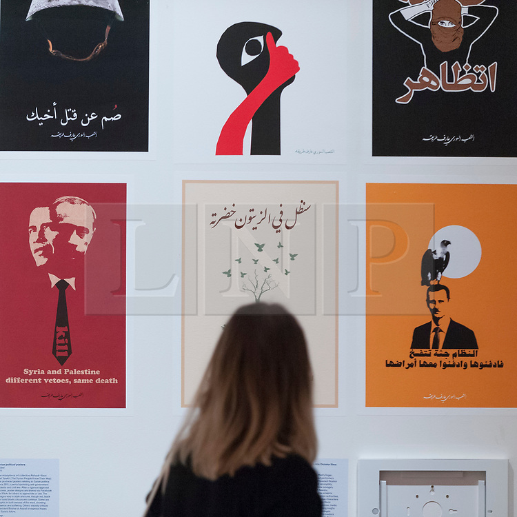 """© Licensed to London News Pictures. 27/03/2018. LONDON, UK. Syrian political posters, by Alshaab Alsori Aref Tarekh (The Syrian People Know Their Way), 2011.  Preview of """"Hope to Nope: Graphics and Politics 2008-18"""", an exhibition examining the political graphic design of a turbulent decade encompassing the 2008 financial crash, Barack Obam presidency, Brexit and Donald Trump's presidency.  The exhibition takes place at the Design Museum 28 March to 12 August 2018.  Photo credit: Stephen Chung/LNP"""