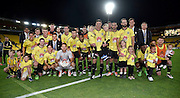Ben Sigmund (C of the Phoenix holding his children with his team after his last game for the Phoenix during the A-League - Wellington Phoenix v Western Sydney football match at Westpac Stadium in Wellington on Sunday the 10 April 2016. Copyright Photo by Marty Melville / www.Photosport.nz
