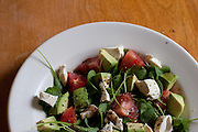 A salad featuring locally grown arugula and tomato.