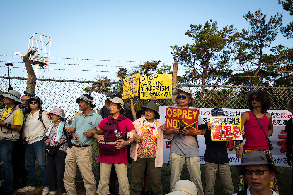 OKINAWA, JAPAN - AUGUST 19 : Anti U.S base protesters with placards staged a protest against the construction of helipads in front of the main gate of U.S. military's Northern Training Area in the village of Higashi, Okinawa Prefecture, on August 19, 2016. Japanese government resume construction of total six helipads in a fragile ten million year old Yanbaru forest that is home to endemic endangered species such as the Okinawan rail and Okinawa wood pecker. (Photo by Richard Atrero de Guzman/NURPhoto)