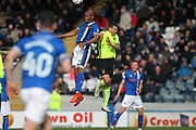 CAlvin Andrew wins a header during the EFL Sky Bet League 1 match between Rochdale and Northampton Town at Spotland, Rochdale, England on 1 April 2017. Photo by Daniel Youngs.