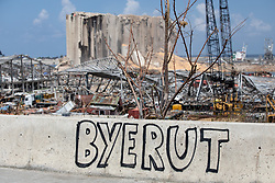 © Licensed to London News Pictures. 10/08/2020. Beirut, Lebanon. Graffiti is seen against a grain silo in Beirut port that was badly damaged following an explosion in Beirut port on Tuesday 4 August. Photo credit : Tom Nicholson/LNP