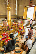 05 MAY 2013 - BANGKOK, THAILAND:  Thais pray in the City Pillar Shrine in Bangkok. The City Pillar Shrine was the first building built in Bangkok, on April 21, 1782, when then King Rama I moved the capital of Siam (now Thailand) from Thonburi to its present location in Bangkok. The shrine is called Lak Mueang in Thai is revered by the residents of Bangkok.      PHOTO BY JACK KURTZ