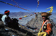Tibetan New Year. Prayer flags fly in the sky over Mt Bombori, just south of Lhasa.