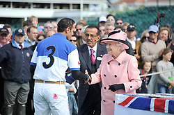 Left to right, MR AHMED MOHAMMED AL HABTOOR (nr 3) HM THE QUEEN and MR KHALAF AL HABTOOR (in waistcoat) at Al Habtoor Royal Windsor Cup Final 2012 at Guards Polo Club, Berkshire on 24th June 2012.