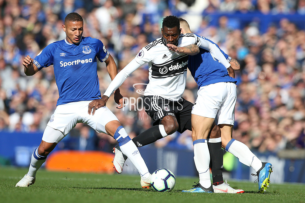 Fulham midfielder Andre-Frank Zambo Anguissa (29) is tackled by Everton striker Richarlison (30) and Everton defender Lucas Digne (12) during the Premier League match between Everton and Fulham at Goodison Park, Liverpool, England on 29 September 2018.