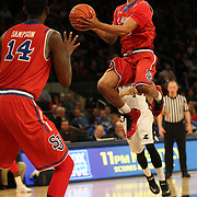 Jamal Branch, St. John's, drives to the basket during the Providence Vs St. John's Red Storm basketball game during the Big East Conference Tournament at Madison Square Garden, New York, USA. 12th March 2014. Photo Tim Clayton