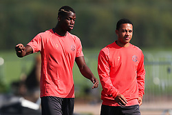 Paul Pogba of Manchester United talks with Memphis Depay - Mandatory by-line: Matt McNulty/JMP - 14/09/2016 - FOOTBALL - Manchester United - Training session ahead of Europa League Group A match against Feyenoord