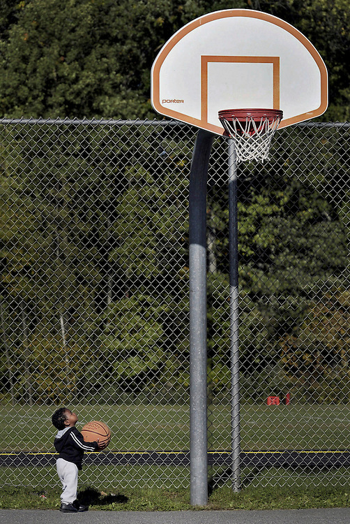 Eighteen-month-old Andrew Whyte Jr., of Windsor Locks, Conn., sizes up his chances for a basket on the court at Coventry High School in Coventry, Conn.