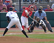 Nebraska's Jake Opitz (3) triples down the first base line against Kansas State's Adam Cowart (L) in the top of the 4th inning.  Nebraska held on to be Kansas State 5-4 at Tointon Stadium in Manhattan, Kansas, April 1, 2006.