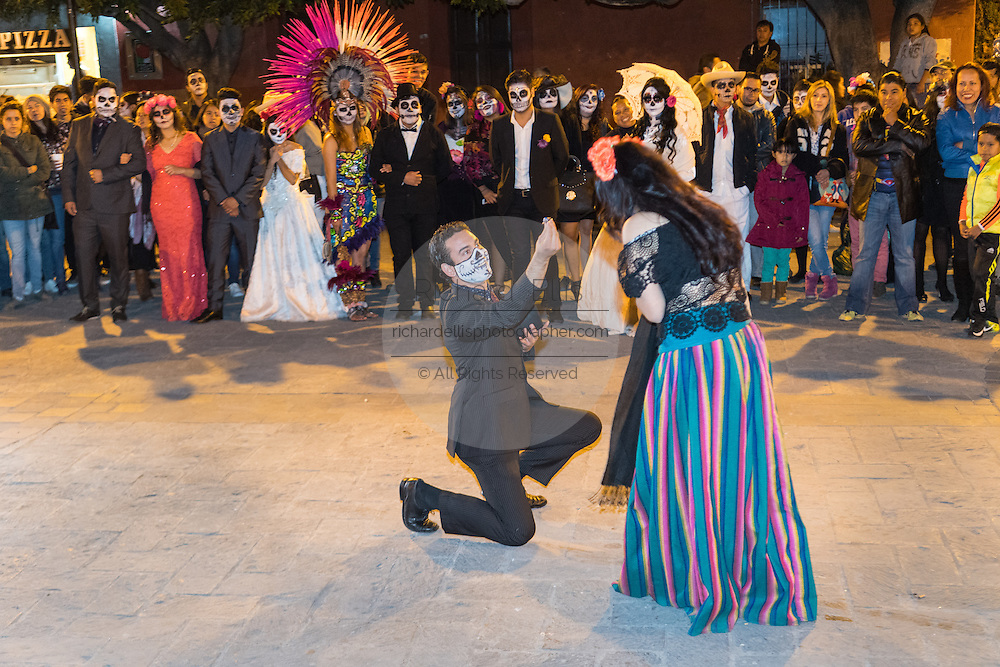 Students perform skits dressed as skeletons during the Day of the Dead festival in the Plaza Civica October 28, 2016 in San Miguel de Allende, Guanajuato, Mexico. The week-long celebration is a time when Mexicans welcome the dead back to earth for a visit and celebrate life.