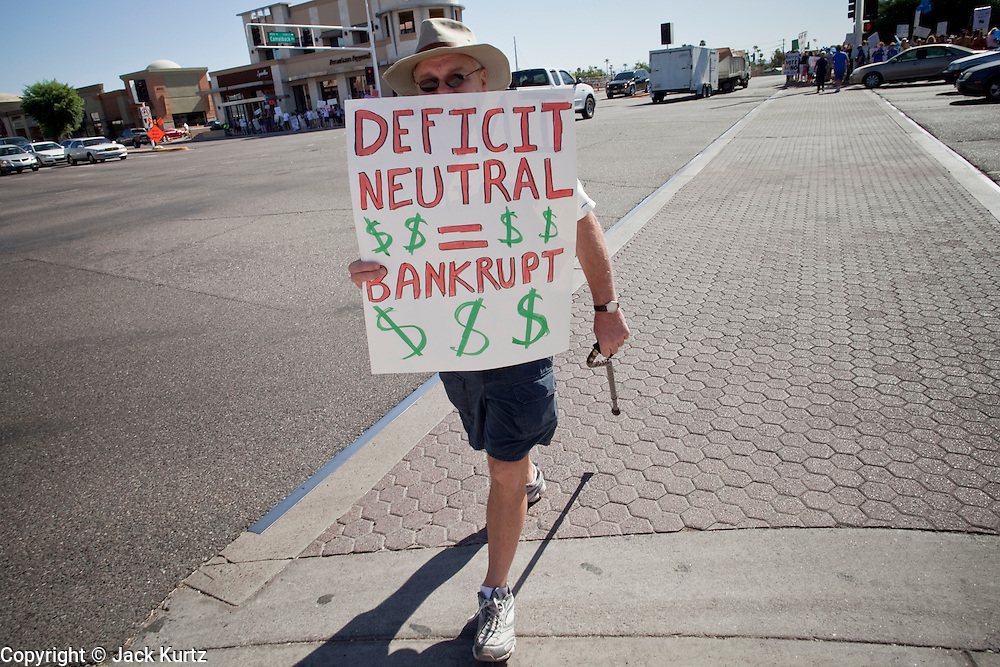 Aug. 8, 2009 -- SCOTTSDALE, AZ: People cross Scottsdale Rd during a protest against the Obama health care plan in Scottsdale, AZ.  Nearly 1,000 people opposed to the President Barack Obama's health care reform efforts picketed the offices of Congresman Harry Mitchell (D-AZ) in Scottsdale, AZ, Saturday. The protest was organized by conservative groups who are organizing similar protests against President Obama across the US. Ostensibly concerned mostly with health care reform, it was also a protest against almost everything related to the Obama administration. Photo by Jack Kurtz / ZUMA Press