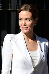 Image ©Licensed to i-Images Picture Agency. 10/06/2014.<br /> <br /> Angelina Jolie (pictured) meets the Prime Minister, David Cameron, and First Secretary of State, William Hague, at 10 Downing Street after attending the Global Summit to End Sexual Violence in Conflict at The ExCel, London, UK.<br /> <br /> Tuesday 10th of June 2014<br /> Picture by Ben Stevens / i-Images