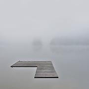 A heavy fog makes a surreal moment on Lake Cavanaugh, Washington.