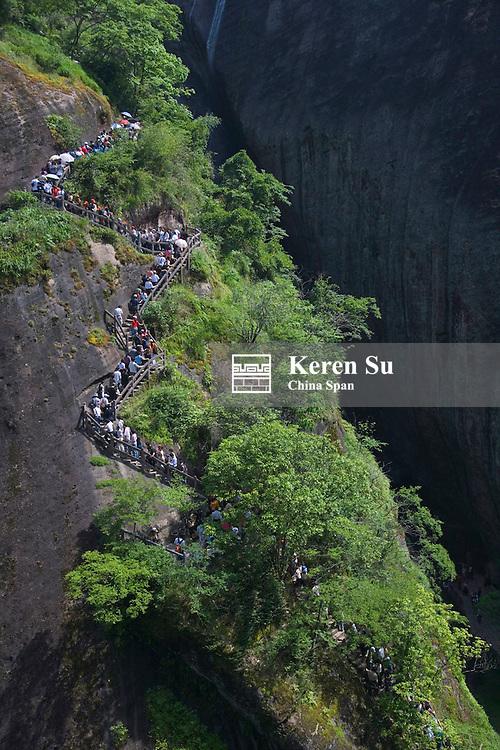 Tourists hike on Mt. Wuyi, Fujian Province, China