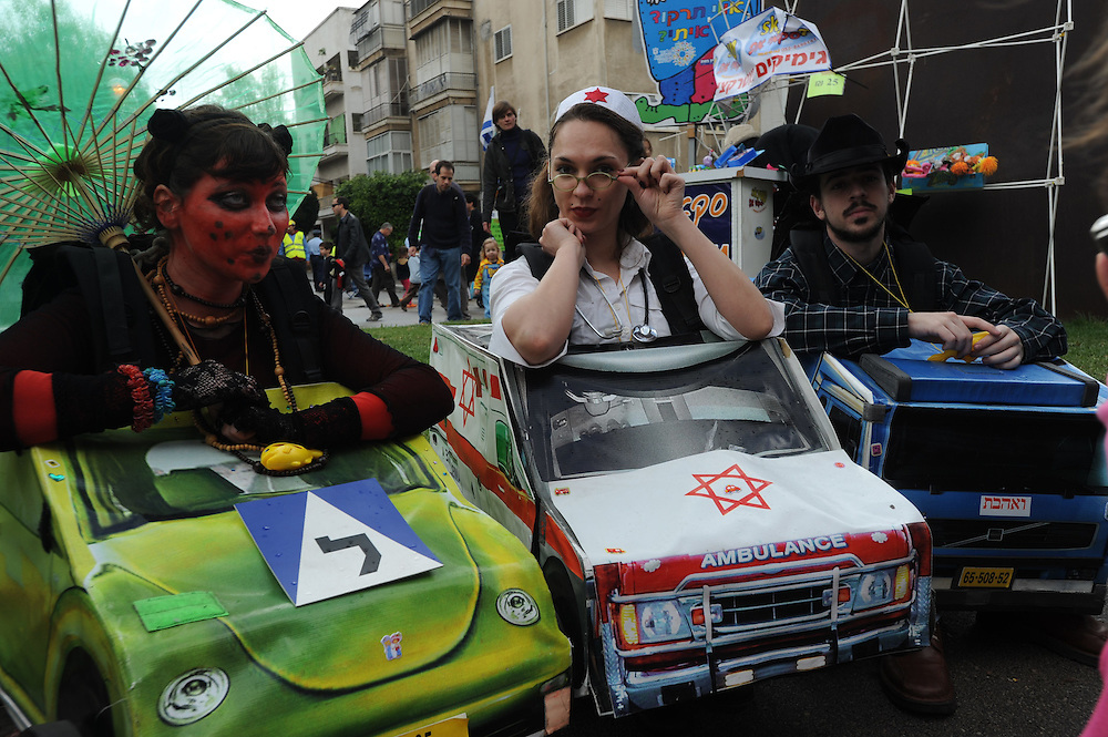 Israelis waering customes are participating Tel Aviv's main Purim event which features the re-creation of Tel Aviv's original zoo which was located where the Gan Ha'ir complex now stands on March 01, 2010.