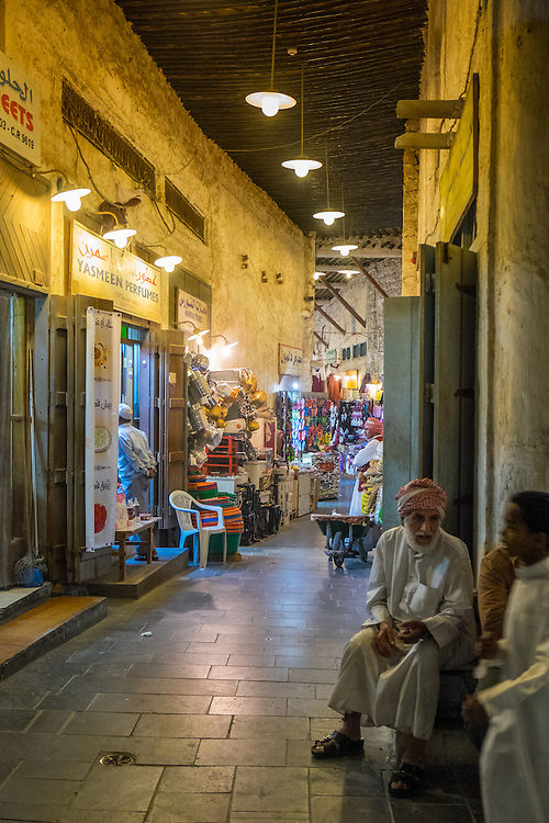 DOHA, QATAR - CIRCA DECEMBER 2013: People at the Souq Waqif. This is a popular and traditional market bazaar in Doha.