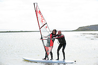 07/05/2013 Ahead of last night's (Tuesday) launch of the Galway Sea Festival which takes place over the June Bank Holiday weekend Actor/performer with The Gombeens, Jonathon Gunning getting windsurfing lessons from Galway woman Katie McAnena, a four-time Irish champion  who is the first ever woman to recently windsurf the infamous surf break off Maui, known as 'Jaws', one of the most iconic waves in the world . There will be taster sessions of Sea Kayaking, Wind Surfing, Canoeing and Diving taking place over the weekend. ..Landlubbers can enjoy will include Beach Safari's, Family Beach Walks, Tug-0-Wars, Sandcastle Competitions and Sand Sculpting Workshops. An early and family-friendly celebration of World Oceans Day will take place on Sunday 2nd June at Galway Atlantaquaria in Salthill featuring exhibits, science shows, diving demonstrations, fish feedings, face painting, story-telling, cartoon-drawing and much more . Picture:Andrew Downes