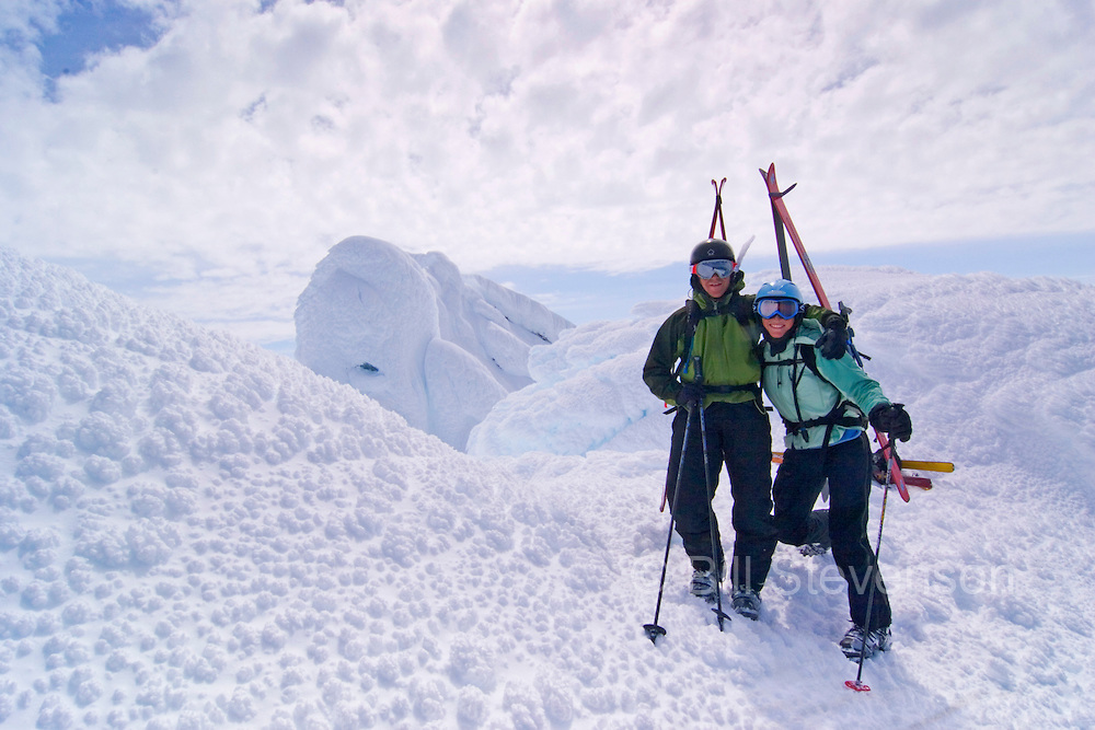 """Suzie and Scott on the summit. Look closely at the """"snow"""". It's actually rime ice. When the wind blows the water vapor in the clouds freezes and accumulates as ice on the windward slopes. We were a little concerned about the conditions."""