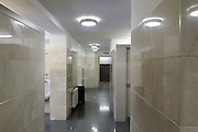 clean male public toilet with marble clad walls