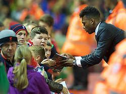 LIVERPOOL, ENGLAND - Wednesday, September 23, 2015: Liverpool's Daniel Sturridge signs autographs for supporters before the Football League Cup 3rd Round match against Carlisle United at Anfield. (Pic by David Rawcliffe/Propaganda)