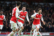Arsenal midfielder Mesut Ozil c#elebrating scoring with his team mates during the Champions League match between Arsenal and Dinamo Zagreb at the Emirates Stadium, London, England on 24 November 2015. Photo by Matthew Redman.