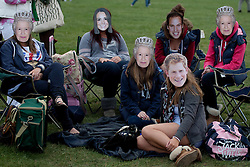LOCATION, UK  29/04/2011. The Royal Wedding of HRH Prince William to Kate Middleton. Royal fans in Hyde Park wearing royal masks wait for the wedding to begin. Photo credit should read Matt Cetti-Roberts/LNP. Please see special instructions. © under license to London News Pictures