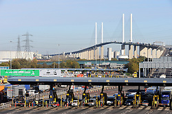 "© Licensed to London News Pictures. 06/11/2014. Heavy traffic at the Dartford Tolls today, 06.11.2014, The toll booths are set to be removed at the Dartford Crossing at the end of this month. From Sunday 30 November 2014 you will no longer pay for the Dartford Crossing at the barriers. An electronic service named ""Dart Charge"" will be introduced. This should help reduce congestion at the crossing (Byline:Grant Falvey/LNP)"