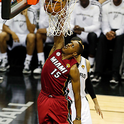 Jun 11, 2013; San Antonio, TX, USA; Miami Heat point guard Mario Chalmers (15) dunks the ball in front of San Antonio Spurs shooting guard Danny Green (4) in the third quarter during game three of the 2013 NBA Finals at the AT&T Center. Mandatory Credit: Derick E. Hingle-USA TODAY Sports