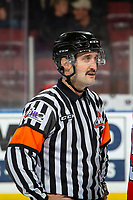 KELOWNA, BC - NOVEMBER 20: Referee Kyle Kowalski stands on the ice at the Kelowna Rockets against the Victoria Royals at Prospera Place on November 20, 2019 in Kelowna, Canada. (Photo by Marissa Baecker/Shoot the Breeze)