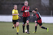 Amy Taylor and Megan Wynne anticipate the long through ball during the Women's FA Cup match between Watford Ladies FC and Brighton Ladies at the Broadwater Stadium, Berkhampstead, United Kingdom on 1 February 2015. Photo by Stuart Butcher.