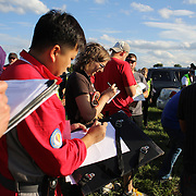 Pilots and support crew check wind speed and direction around rural Michigan near Battle Creek during the World Hot Air Ballooning Championships. Battle Creek, Michigan, USA. 20th August 2012. Photo Tim Clayton
