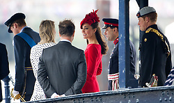 © Licensed to London News Pictures. 03/06/2012. London, UK. Kate Middleton, Prince WIlliam and Prince Harry arriving Cadogan Pier to board the Royal Barge Gloriana during the Jubilee Pageant on the River Thames, London on June 03,2012 as part of The Diamond Jubilee celebrations. Great Britain is celebrating the 60th  anniversary of the countries Monarch HRH Queen Elizabeth II accession to the throne . Photo credit : Ben Cawthra/LNP