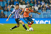 Morgan Fox of Sheffield Wednesday and Theo Walcott of Everton contest a loose ball  during the EFL Cup match between Sheffield Wednesday and Everton at Hillsborough, Sheffield, England on 24 September 2019.