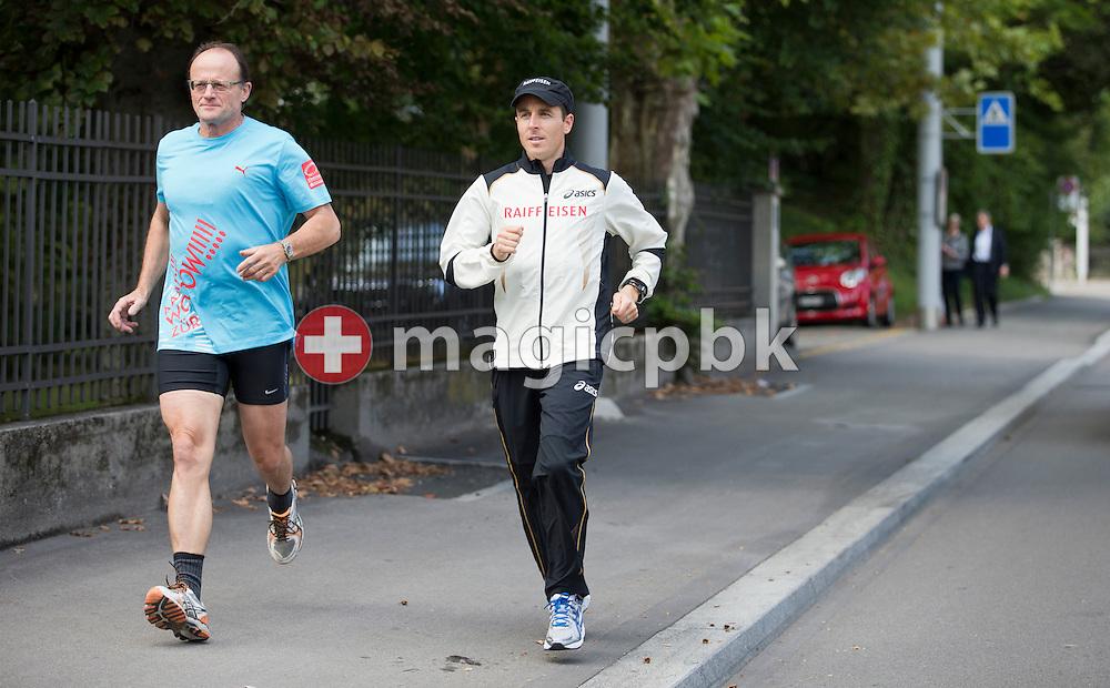 (L-R) Gerold Lauber, Zuercher Stadtrat, und Viktor Roethlin, erfolgreichster Schweizer Marathonlaeufer, unterwegs auf der Raemistrasse anlaesslich der Praesentation der Marathon-Strecke fuer die Leichtathletik EM 2014 in Zuerich am Donnerstag, 13. September 2012. (Photo by Patrick B. Kraemer/zuerich2014.ch)