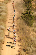 The leading bunch crosses a dam wall in the Witzenberg Valley during stage 2 of the 2011 Absa Cape Epic Mountain Bike stage race held from Saronsberg Wine Estate in Tulbagh, South Africa on the 29 March 2011..Photo by Greg Beadle/Cape Epic/SPORTZPICS