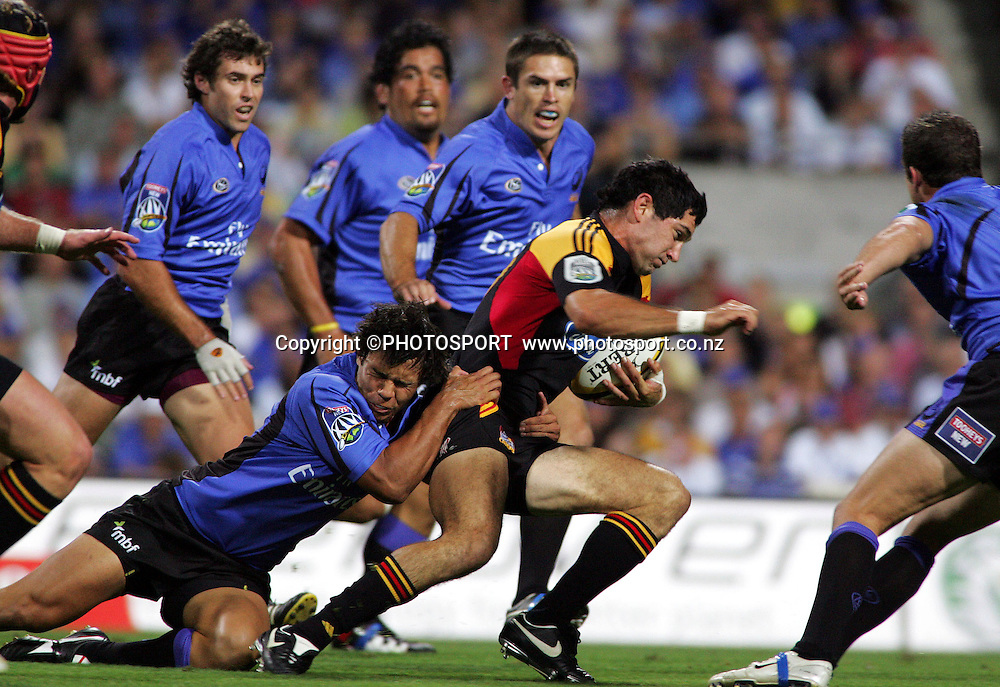 #10 Stephen Donald tries to break free from the Force's Scott Daruda during the 2006 Super 14 rugby union match between the Western Force and the Chiefs at Subiaco Oval, Perth, Western Australia, on Friday 24 February, 2006. Final score was Force - 9, Chiefs - 26.  Photo: Christian Sprogoe/PHOTOSPORT