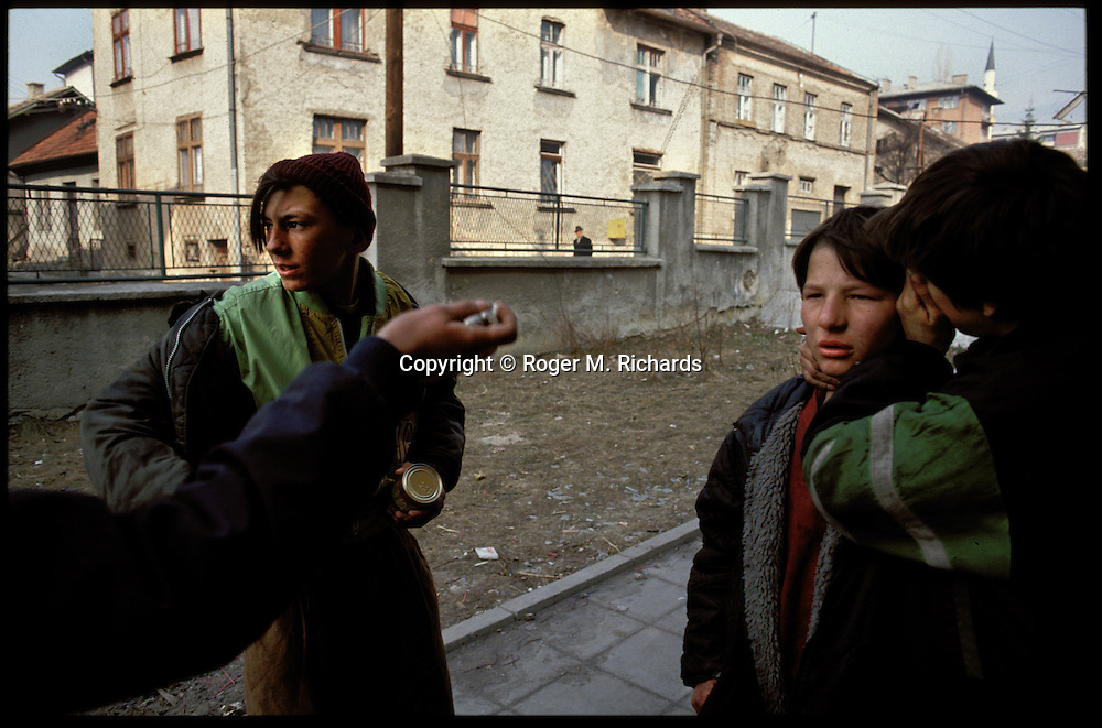 A gang of orphans who steal to survive outside the children's orphanage almost one year into the Serb siege of the city, Sarajevo, Bosnia and Herzegovina, February 1993. PHOTO BY ROGER RICHARDS