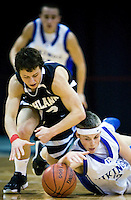JEROME A. POLLOS/Press..Coeur d'Alene's Nate Clinton dives for a ball he forced loose from Highland High's Alex Carlson during the first half of Friday's game at the Idaho Center in Nampa.