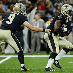 Aug 26, 2017; New Orleans, LA, USA; New Orleans Saints quarterback Drew Brees (9) hands off to running back Adrian Peterson (28) during the first half of a preseason game against the Houston Texans at the Mercedes-Benz Superdome. Mandatory Credit: Derick E. Hingle-USA TODAY Sports