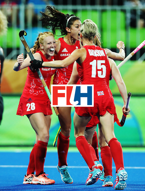 RIO DE JANEIRO, BRAZIL - AUGUST 19:  Lily Owsley of Great Britain celebrates scoring her teams third goal during the Women's Hockey final between Great Britain and the Netherlands on day 14 at Olympic Hockey Centre on August 19, 2016 in Rio de Janeiro, Brazil. (Photo by Ian MacNicol/Getty Images)