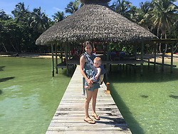 EXCLUSIVE: How about owning your own tropical Caribbean luxury resort for just $10. American couple Suzanne and Dave Smith are selling off their incredible Casa Cayuco Eco Adventure Lodge, in Bocas del Toro, Panama, Central America. But instead of listing their stunning multi-million-pound island getaway for sale they are offering the chance for anyone who buys a $10 ticket to win their extraordinary lifestyle and profitable business. Dave and Suzanne have spent five years turning a former rustic lodge into one that has just been voted number one resort on TripAdvisor in Panama. Their incredible two-acre slice of heaven is bordered by sloth-filled rainforest to the rear and crystal clear coral sea to the front. The lucky winner of the 24-guest resort will become owner of four stand-alone cabins, a main lodge, two lodge suites, and an air-conditioned luxury owner's suite designed by Dave and Suzanne themselves and built by skilled local carpenters. Outside, Casa Cayuco comes with its own jetty and thatch covered sun terrace as well as everything you need to run a business, including commercial kitchen communication tower, laundry and maintenance building and THREE power boats, each over 23-foot long. Kayaks, snorkelling, spear fishing and paddle boards and surf gear are also ready and waiting to be used by a new owner and guests alike. And if that's not enough, British competition organisers WinThis.Life https://winthis.life/index.aspx# are offering a $50,000 cash injection to welcome the new owners. All those wishing to take part have to do is buy one or more tickets and play a spot-the-ball-type competition on the website. Entries are being taken extension until April 11. Dave, 35, and Suzanne, 33, first arrived on the island in 2013 with just seven suitcases having decided to sell up from their home and corporate lives near Detroit, Michigan, USA. 16 Feb 2018 Pictured: Pic shows present owner Suzanne Smith and her daughter Mina at Caribbean resort Casa Cayuco