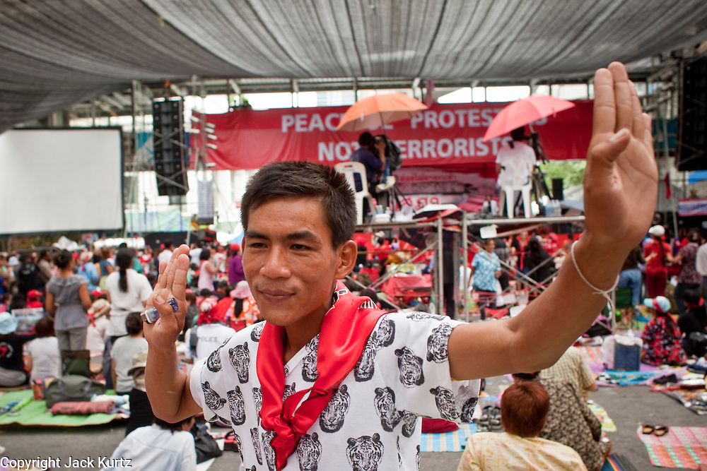 """May 12 - BANGKOK, THAILAND: People party in front of the Red Shirts' main stage Wednesday. The Thai government said Wednesday that time has run out for """"Red Shirt"""" protesters in Ratchaprasong and Sala Daeng intersections in Bangkok and that a crackdown could come at any time. As news of the anticipated crackdown spread, Red Shirt protesters continued with an almost festive mood at their main stage but many of the sleeping areas around the protest site appeared to be empty. No official estimates on crowd size are available.  Photo by Jack Kurtz"""
