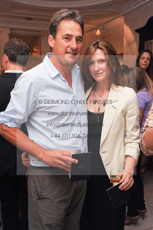 TIM BEVAN and his wife AMY he is the former husband of Joely Richardson at a party to celebrate the launch of Page One an online guide to London's 100 most rewarding restaurants held at the Halcyon Gallery, Bruton Street, London on 7th July 2010.