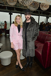 Singer LAUREL ARNELL-CULLEN and singer-songwriter LEON ELSE at the mothers2mothers World AIDS Day VIP Lunch with Next Management & THE OUTNET.COM held at Mondrian London, 19 Upper Ground, London on 1st December 2014.
