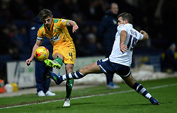 Yeovil Town's Joe Edwards is challenged by  Preston North End's John Welsh- Photo mandatory by-line: Richard Martin-Roberts - Mobile: 07966 386802 - 20/01/2015 - SPORT - Football - Preston - Deepdale Stadium - Preston North End v Yeovil Town - Sky Bet League One