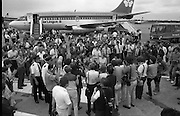 1983-15-08.15th August 1983.15-08-1983.08-15-83..Photographed at Dublin Airport..Pressed:..Gold medalist Eamonn Coughlan geeeted by press and supporters on the tarmac of Dublin Airport on his return from the World Athletic Championships in Finland. His wife Yvonne and chldren Suzanne (four) and Eamonn Jn (two) are with him. Suzanne is in his arms while his wife holds Eamonn Jn. His mother Kathleen is beside Yvonne..