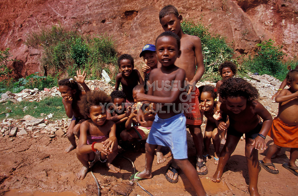 A group of kids playing in the mud, Brazil, 2000's