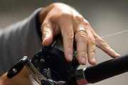 September 19, 2010 - The hands of Richard F. Troise help guide line through the Okuma fishing reel and down the Ugly Stick Tiger rod he uses to fly his kite in Boston Common. Troise stated he was a former fisherman who liked to fish for Salmon. Photo by Lathan Goumas, COM 2011.
