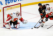Anaheim Ducks forward Richard Rakell (2nd R) tries to get a shot in on Calgary Flames goalie Mike Smith (L) during a 2017-2018 NHL hockey game in Anaheim, California, the United States, on Oct. 9, 2017.  Calgary Flames won 2-0. (Xinhua/Zhao Hanrong)